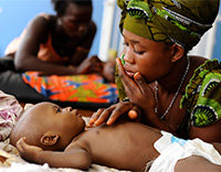 A mother and child at a health center in Freetown, Sierra Leone.