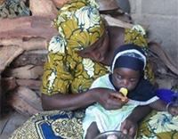 Mother feeding her child.