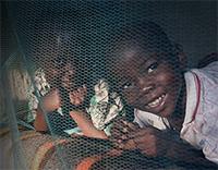 Newsletter-January---Children-sleeping-under-mosquito-net