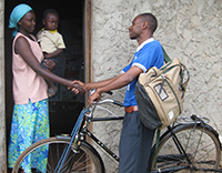 Community Health Worker and Mother with Child.